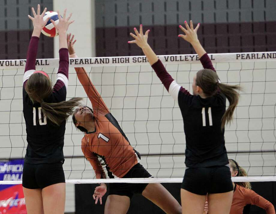 Pearland's Brooke Botkin left, and Alvin's Cholee Holden center, and Pearland's Riley Murdock right, during high school volleyball game action at Pearland High School Tuesday, Oct. 15, 2013, in Pearland. Photo: James Nielsen, Houston Chronicle / © 2013  Houston Chronicle