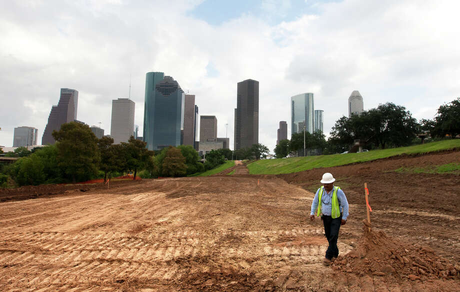 The transfor-mation of the city's Buffalo Bayou Park is underway in partnership with a non-profit group. The city is considering  a similar  arrangement with the Houston Parks Board for the  Greenways initiative. Photo: Cody Duty, Staff / © 2013 Houston Chronicle