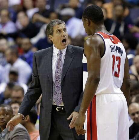 Washington coach Randy Wittman and forward Kevin Seraphin have a discussion against Miami. Photo: Alex Brandon / Associated Press