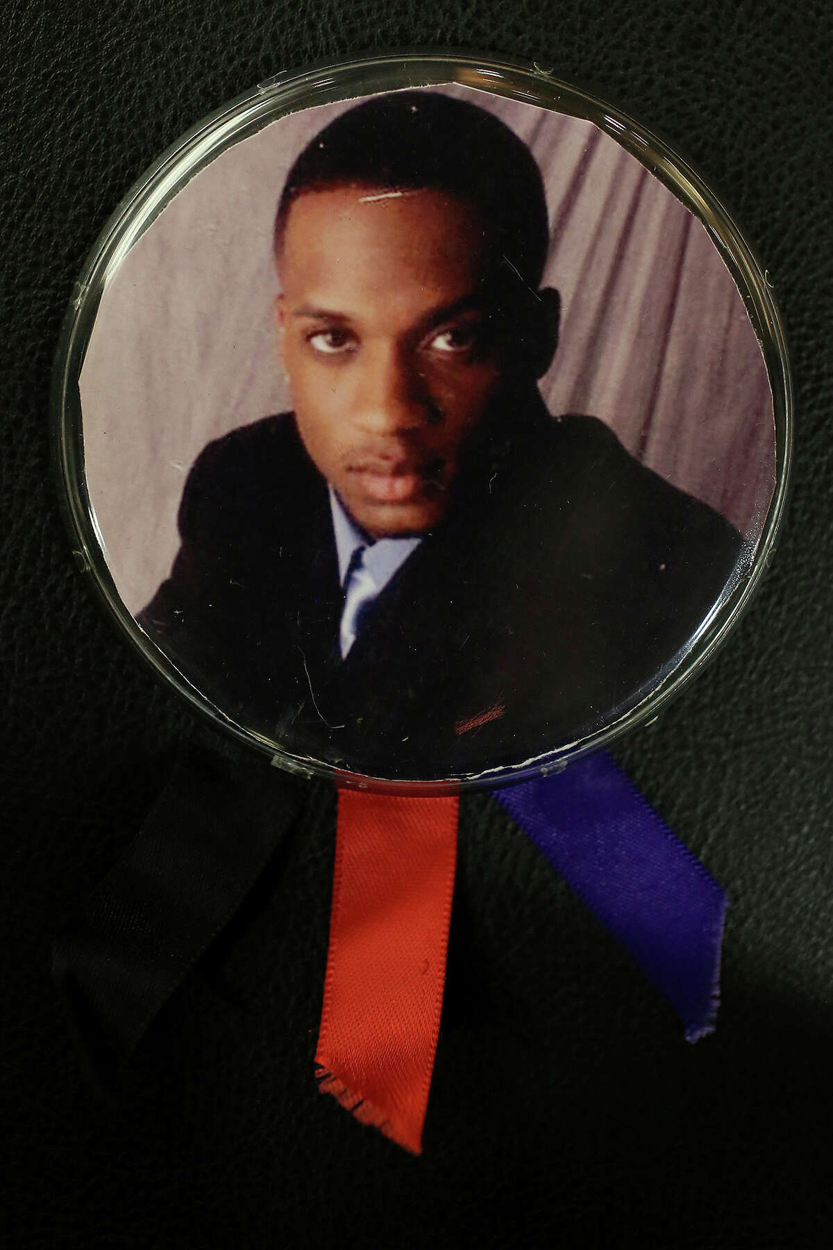 A button with a photograph of Samuel Johnson, Jr. carried by his mother, Stephanie Johnson, during the trial of Bernard