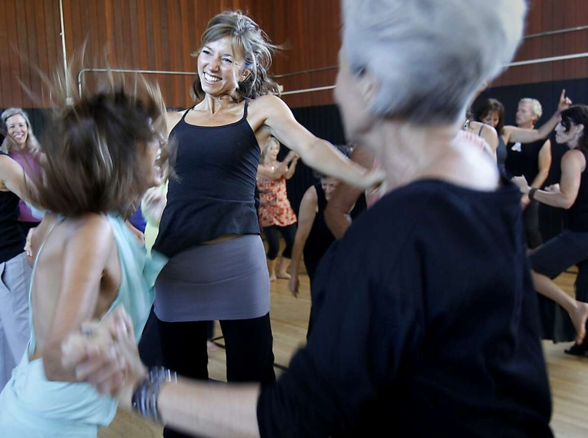 A group of women bounced on the floor of the gym as the music moved them Sunday September 15, 2013 in Sausalito, Calif. A weekly event called