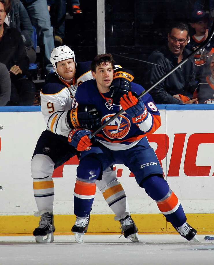 UNIONDALE, NY - OCTOBER 15: Steve Ott #9 of the Buffalo Sabres holds on to John Tavares #91 of the New York Islanders in the third period at the Nassau Veterans Memorial Coliseum on October 15, 2013 in Uniondale, New York. The Sabres defeated the Islanders 4-3 in the shootout. (Photo by Bruce Bennett/Getty Images) ORG XMIT: 181108119 Photo: Bruce Bennett / 2013 Getty Images