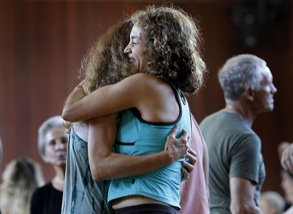 Two women embraced while people danced all around them Sunday September 15, 2013 in Sausalito, Calif. A weekly event called