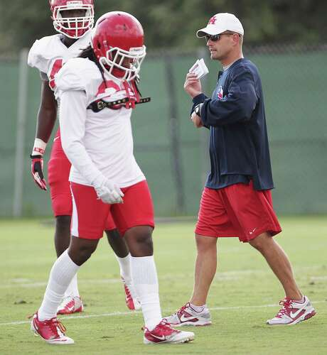 First-year Houston defensive coordinator David Gibbs helps his players prep Tuesday for their biggest challenge to date - Saturday's game with BYU. Photo: James Nielsen, Staff / © 2013  Houston Chronicle