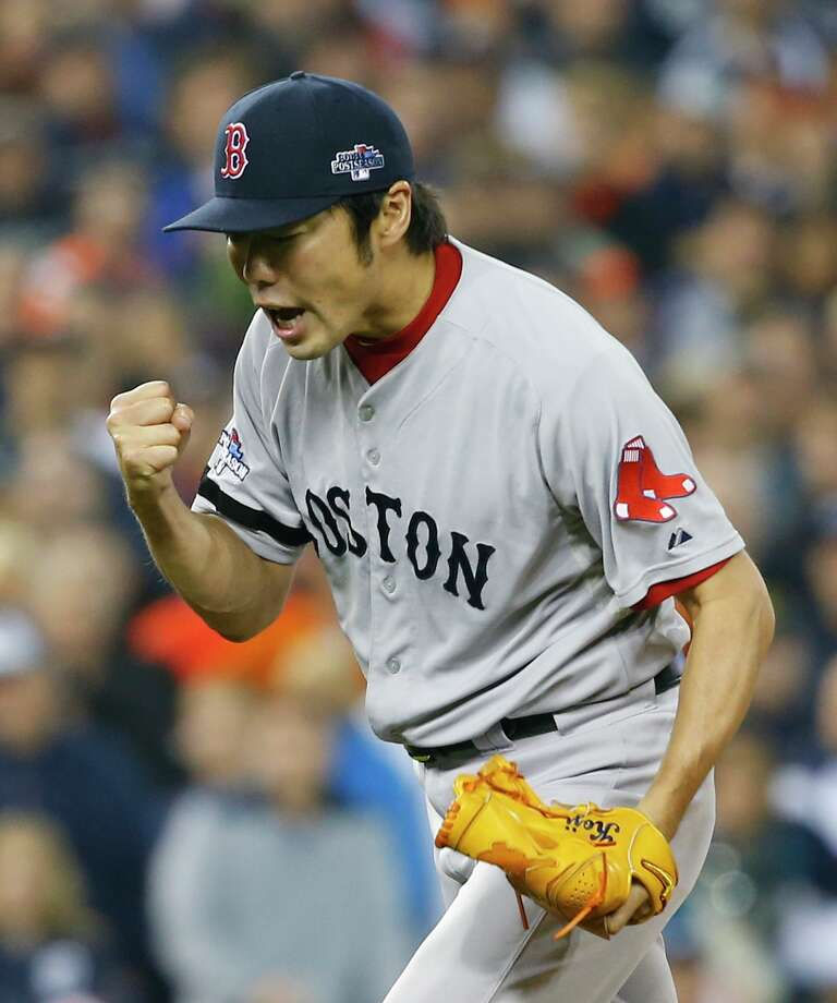 Boston Red Sox's Koji Uehara celebrates after the Red Sox defeated the Detroit Tigers 1-0 in Game 3 of the American League baseball championship series Tuesday, Oct. 15, 2013, in Detroit. (AP Photo/Paul Sancya) ORG XMIT: ALCS200 Photo: Paul Sancya / AP