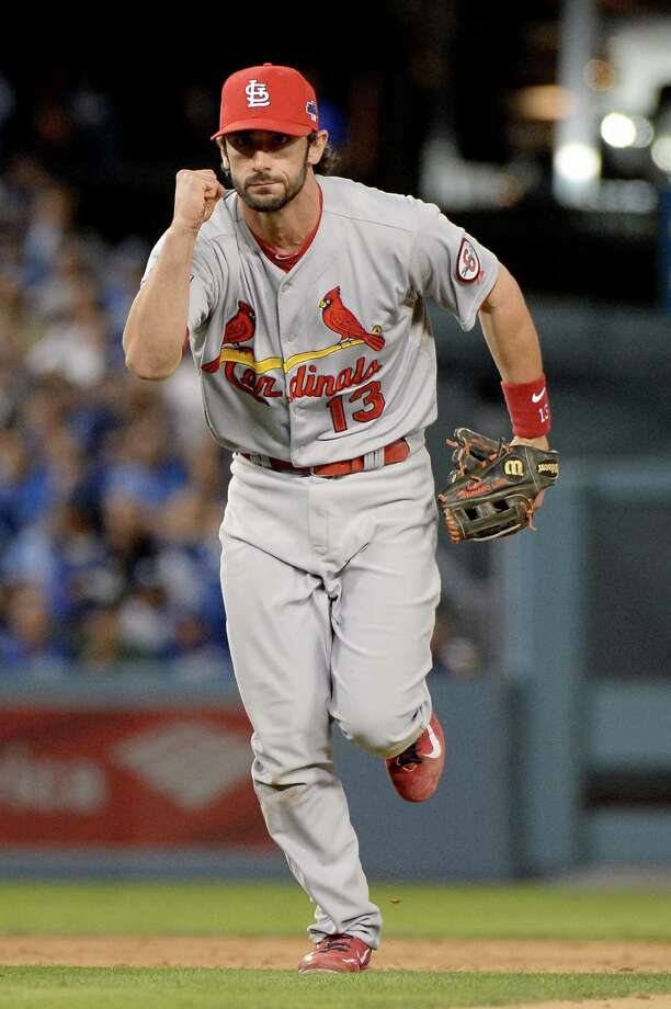 LOS ANGELES, CA - OCTOBER 15:  Matt Carpenter #13 of the St. Louis Cardinals celebrates after he turns a double play in the sixth inning as Yasiel Puig #66 of the Los Angeles Dodgers is out at second base in Game Four of the National League Championship Series at Dodger Stadium on October 15, 2013 in Los Angeles, California.  (Photo by Harry How/Getty Images) ORG XMIT: 184309408 Photo: Harry How / 2013 Getty Images