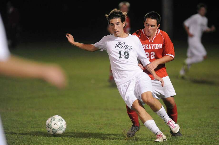 Shenendehowa's Austin Hughes looks to pass to a teammate as Niskayuna's Adam Downey defends during their boy's high school soccer game on Tuesday Oct. 15, 2013 in Clifton Park, N.Y. (Michael P. Farrell/Times Union) Photo: Michael P. Farrell / 00024213A