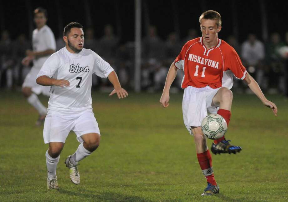 Shenendehowa's Joshua Barlow, and Niskayuna's Alec Hay battle for the ball during their boy's high school soccer game on Tuesday Oct. 15, 2013 in Clifton Park, N.Y. (Michael P. Farrell/Times Union) Photo: Michael P. Farrell / 00024213A