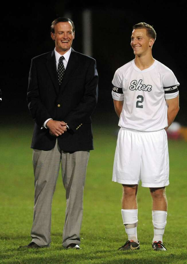 Shenendehowa's Philip Barrett, right, with his father Clifton Park Town Supervisor Philip Barrett before the start of the boy's high school soccer game against Niskayuna on Tuesday Oct. 15, 2013 in Clifton Park, N.Y. (Michael P. Farrell/Times Union) Photo: Michael P. Farrell / 00024213A