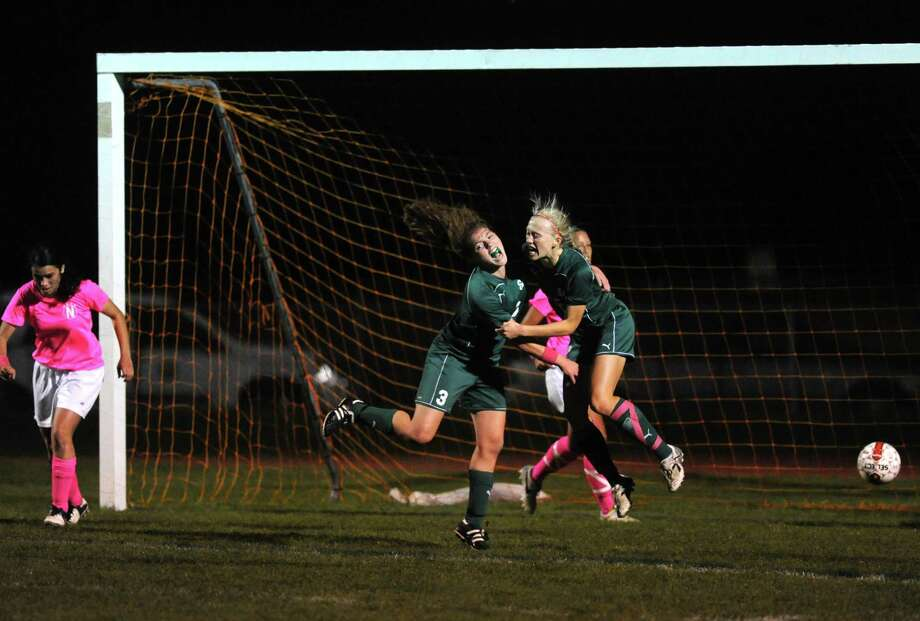 Shenendehowa's Madison Shea, left center, and Katherine Benson celebrate after Benson scored a goal during their girls high school soccer game against Niskayuna on Tuesday Oct. 15, 2013 in Niskayuna, N.Y. (Michael P. Farrell/Times Union) Photo: Michael P. Farrell / 00024255A
