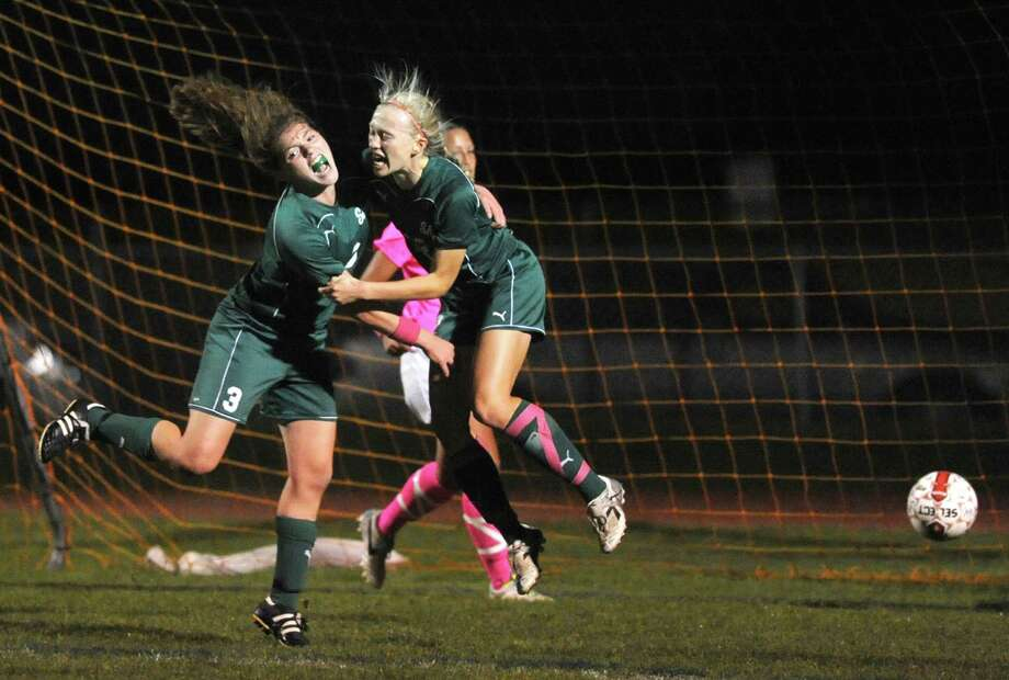 Shenendehowa's Madison Shea, left, and Katherine Benson celebrate after Benson scored a goal during their girls high school soccer game against Niskayuna on Tuesday Oct. 15, 2013 in Niskayuna, N.Y. (Michael P. Farrell/Times Union) Photo: Michael P. Farrell / 00024255A