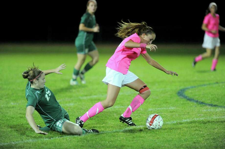 Niskayuna's Madison McPartlon breaks with the past Shen's Meghan Cavanaugh during their girls high school soccer game on Tuesday Oct. 15, 2013 in Niskayuna, N.Y. (Michael P. Farrell/Times Union) Photo: Michael P. Farrell / 00024255A