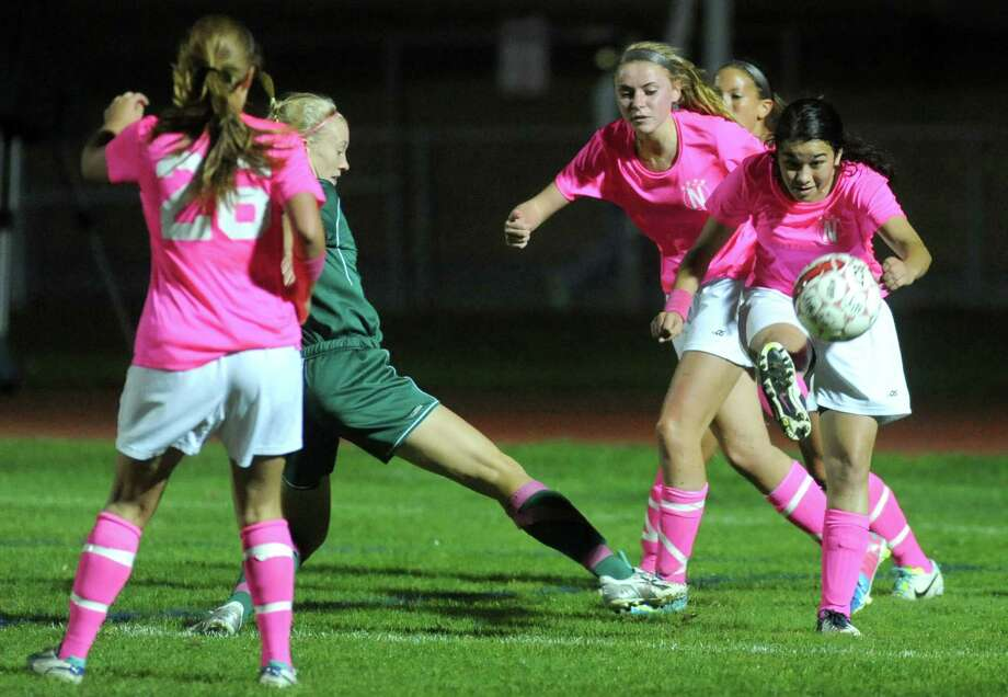 Niskayuna's Olivia Golden, right, kicks the ball during their girls high school soccer game against Shenendehowa on Tuesday Oct. 15, 2013 in Niskayuna, N.Y. (Michael P. Farrell/Times Union) Photo: Michael P. Farrell / 00024255A