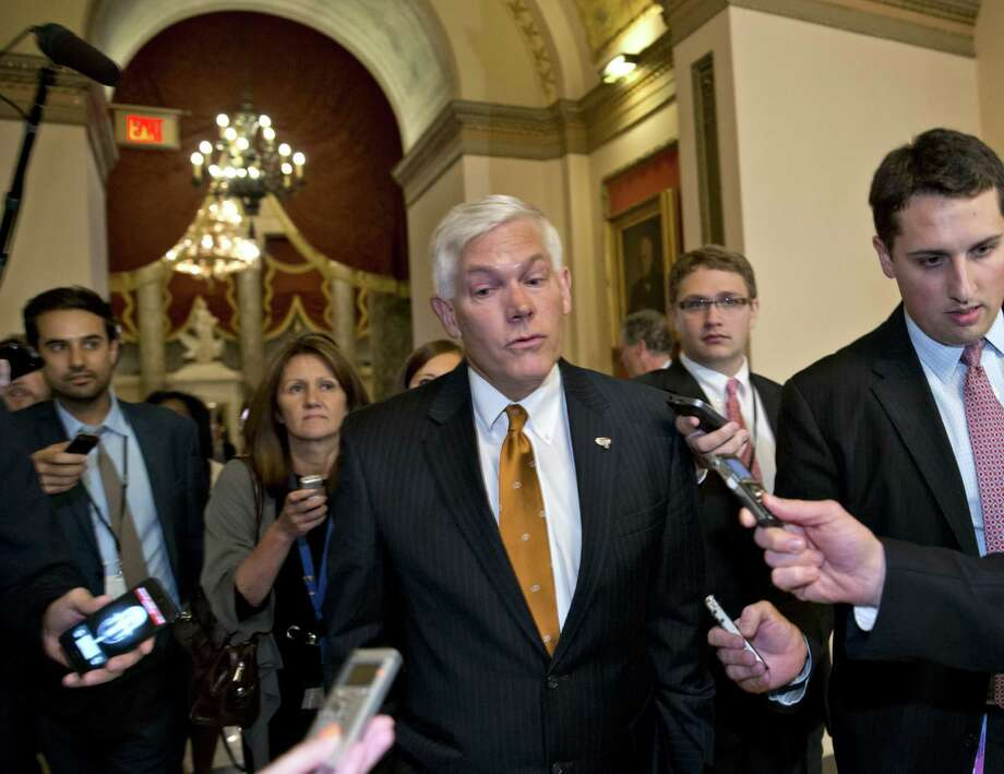 House Rules Committee Chairman Pete Sessions, R-Dallas, emerges from Speaker John Boehner's office to tell reporters there won't be an evening budget vote. Photo: J. Scott Applewhite / Associated Press