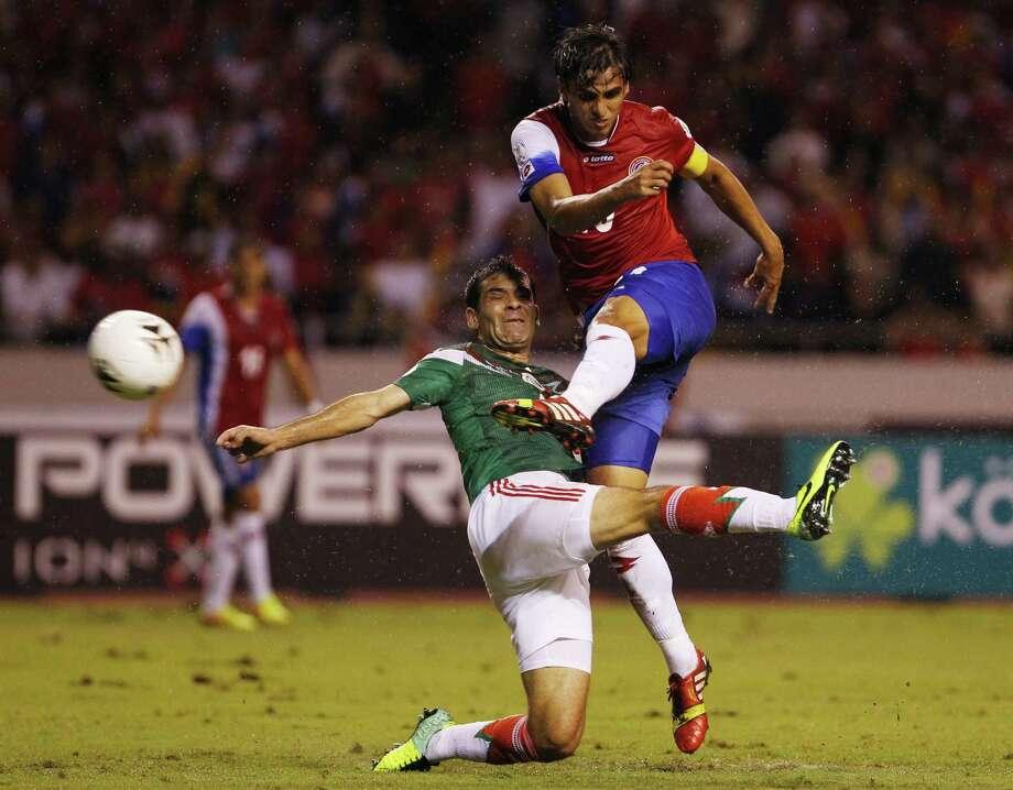 Mexico's Rafael Marquez (left) can't stop Costa Rica's Bryan Ruiz from scoring during Tuesday's World Cup qualifier in San Jose, Costa Rica. Photo: Fernando Vergara / Associated Press