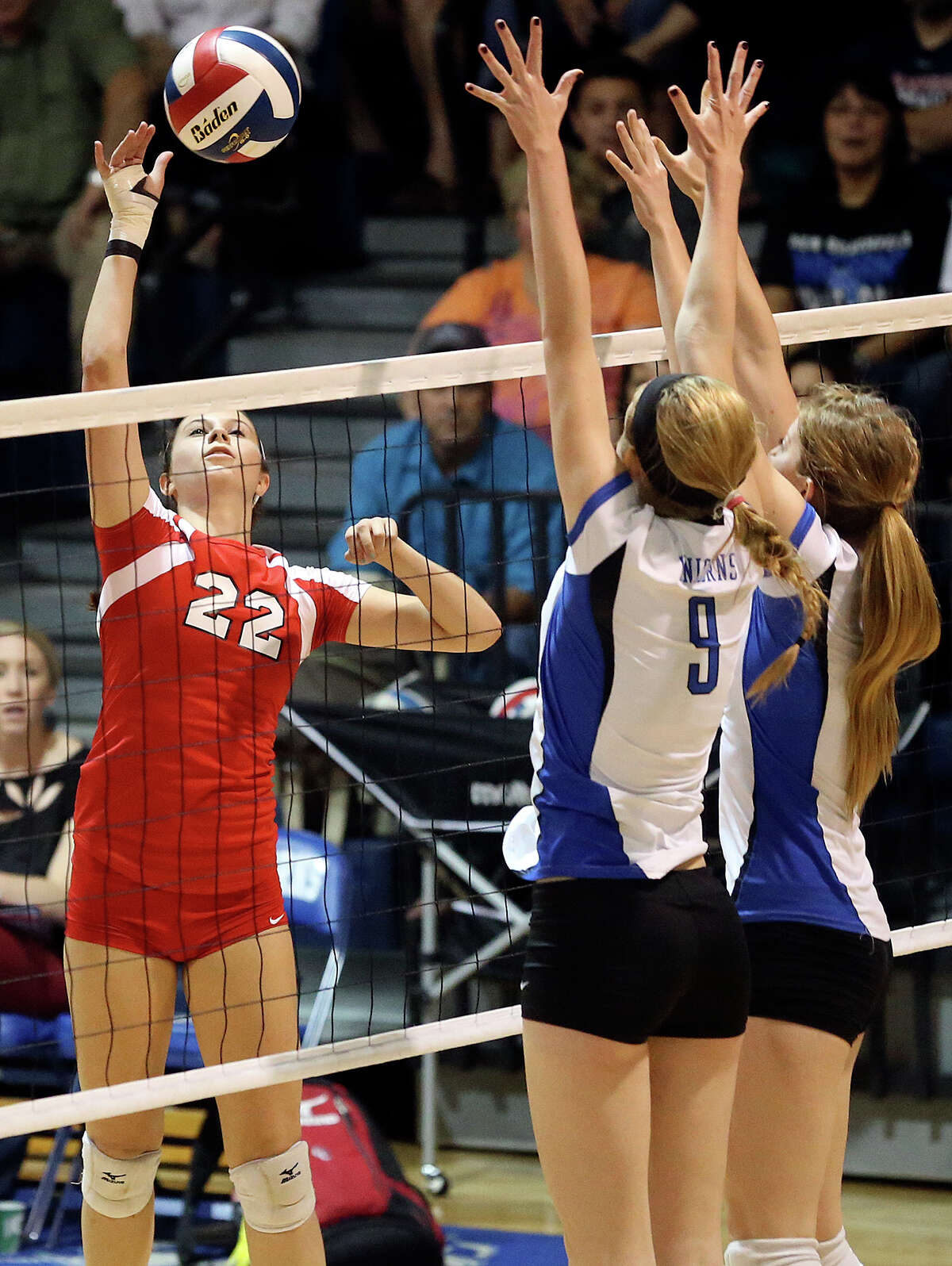 Canyon's Madison Williams gets the ball by Unicorn defenders Neka Cuppettilli and Alexis Uleman as New Braunfels hosts Canyon in volleyball at New Braunfels High School gym on October 15, 2013.