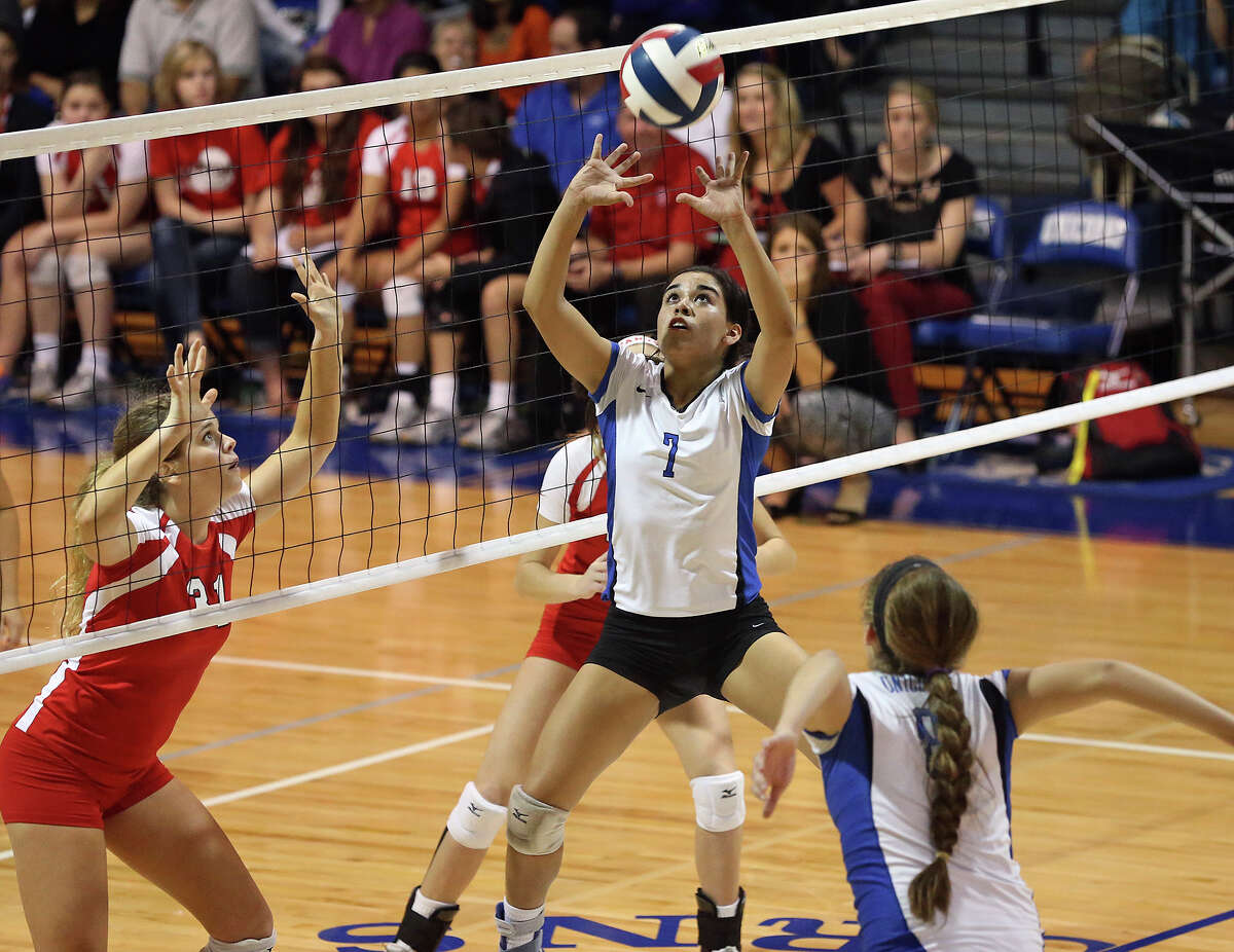 Amanda Gonzales sets the ball for the Unicorns as New Braunfels hosts Canyon in volleyball at New Braunfels High School gym on October 15, 2013.