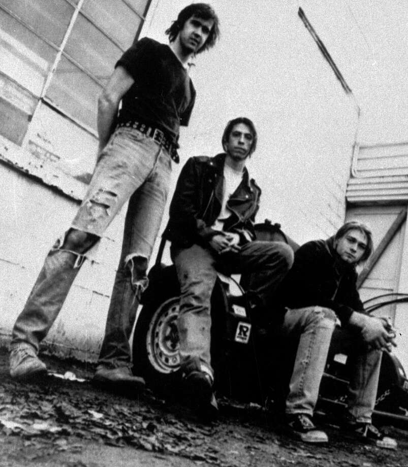 FILE - Members of the band Nirvana shown in a 1991 file photo, from left, Krist Novoselic, David Grohl, and Kurt Cobain.  Nirvana, Linda Ronstadt, Peter Gabriel, Hall and Oates, and The Replacements are among first-time nominees to the Rock and Roll Hall of Fame. The hall of fame announced its annual list of nominees Wednesday morning, Oct. 16, 2013, and half the field of 16 were first-time nominees. (AP Photo/Chris Cuffaro, File) ORG XMIT: CAET116 Photo: Chris Cuffaro / Chris Cuffaro
