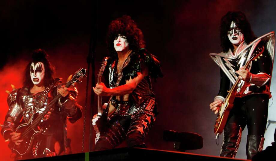 FILE - In this Sept. 29, 2012 file photo, members of the band Kiss, from left, Gene Simmons, Paul Stanley and Tommy Thayer perform during a concert in Mexico City. The hall of fame announced its annual list of nominees Wednesday morning, Oct. 16, 2013, and half the field of 16 were first-time nominees, such as Nirvana, Linda Ronstadt, Peter Gabriel, Hall and Oates, The Replacements, and others.  KISS, LL Cool J, N.W.A., Cat Stevens, Deep Purple and Chic, up for the eighth time since 2003, are among the repeat nominees. (AP Photo/Marco Ugarte, File) ORG XMIT: CAET120 Photo: Marco Ugarte / AP