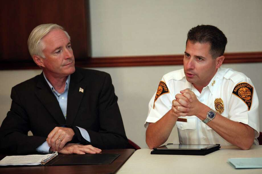 Mayor Bill Finch, left,  and Assistant Police Chief James Nardozzi  speak at a roundtable discussion regarding the next steps in the fight against gun violence at Bridgeport City Hall on Monday, Sept. 23, 2013. Photo: BK Angeletti, B.K. Angeletti / Connecticut Post freelance B.K. Angeletti
