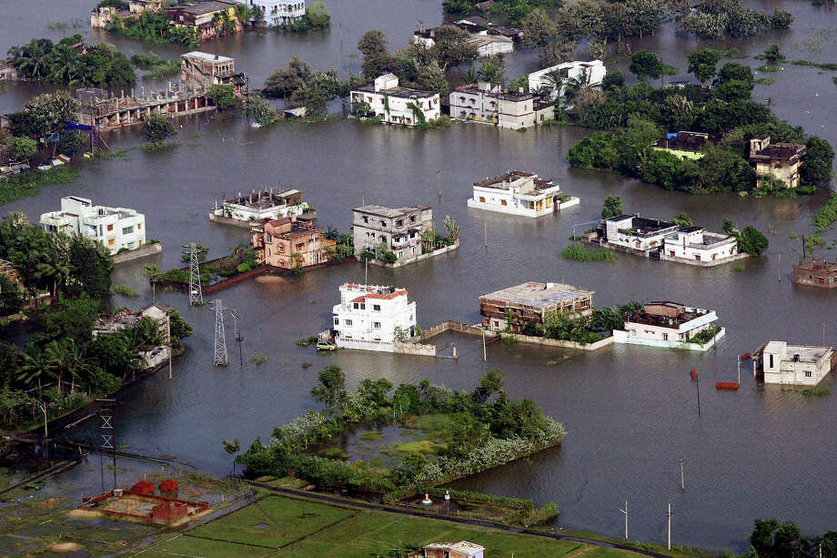 An aerial view shows an area flooded by heavy rains in the aftermath of Cyclone Phailin in Balasore district, Orissa state, India, Tuesday, Oct. 15, 2013. A mass government evacuation of nearly 1 million people spared India the widespread deaths many had feared from the powerful weekend cyclone Phailin, which destroyed hundreds of millions of dollars' worth of crops and tens of thousands of homes. Photo: Uncredited, ASSOCIATED PRESS / AP2013