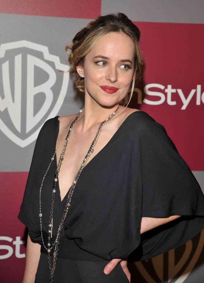 Actress Dakota Johnson arrives at the 2011 InStyle And Warner Bros. 68th Annual Golden Globe Awards post-party held at The Beverly Hilton hotel on January 16, 2011 in Beverly Hills, California. Photo: Lester Cohen, WireImage
