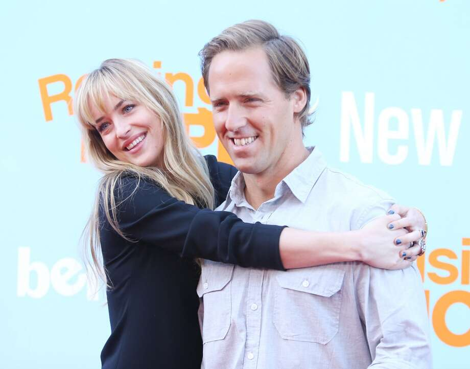 Dakota Johnson (L) and Nat Faxon arrive at the New FOX Tuesday screening event held at The Broad Stage on August 26, 2012 in Santa Monica, California.  (Photo by Michael Tran/FilmMagic) Photo: Michael Tran, FilmMagic