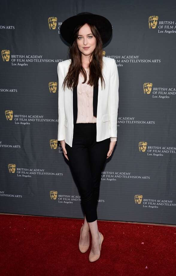 Actress Dakota Johnson attend the 26th Annual BAFTA LA Garden Party at the British Consuls General Residence on  June 2, 2013 in Los Angeles, California.  (Photo by Frazer Harrison/Getty Images) Photo: Frazer Harrison, Getty Images