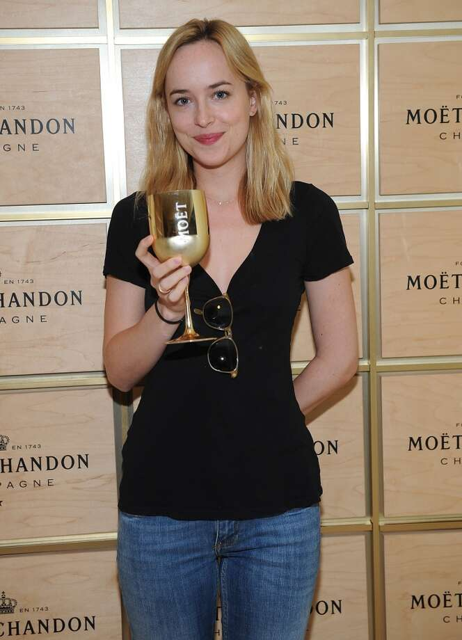 Actress Dakota Johnson attends The Moet & Chandon Suite at the USTA Billie Jean King National Tennis Center on August 27, 2013 in New York City.  (Photo by Brad Barket/Getty Images for Moet & Chandon) Photo: Brad Barket, Getty Images For Moet & Chandon
