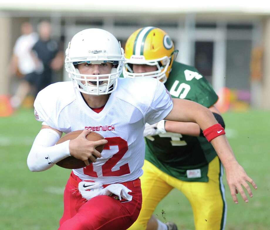 You can look into the steely eyes of Greenwich Cardinal's quarterback Matt Marzulla in this photo taken by staff photographer Bob Luckey during Greenwich's recent football game against rival Trinity Catholic High School. Marzulla led the Cardinals to a 42-14 in the game. Photo: Bob Luckey / Greenwich Time