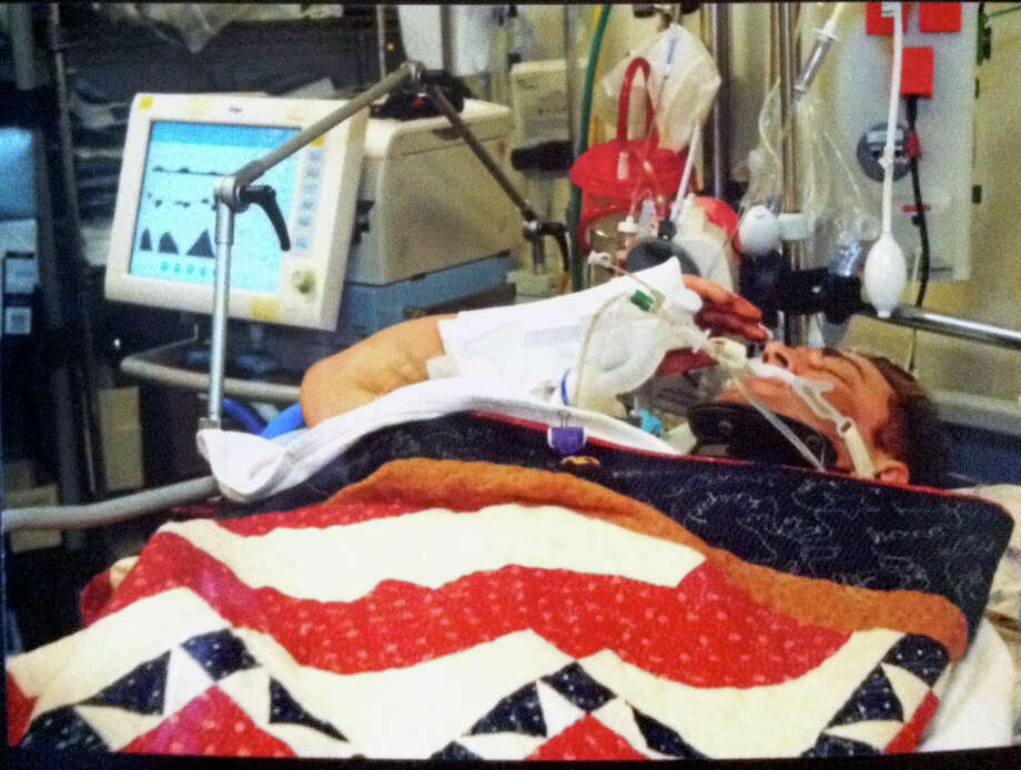 Army Ranger Josh Hargis, seen in a photo provided Oct. 12, 2013 by Josh Hargis' commander to Hargis' wife, Taylor Hargis, salutes from his hospital bed in Afghanistan after receiving a purple heart for wounds he sustained during an attack. The photo and the story behind it have gone viral, spreading quickly through media outlets and social media. Hargis, who has a sister stationed at JBSA-Ft. Sam Houston has been moved to SAMMC for treatment.    Taylor Hargis's Facebook page. Photo: Courtesy Photo / COURTESY TAYLOR HARGIS VIA FACEBOOK