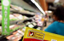 The label from a package of Foster Farms chicken is displayed as a woman shops in a Los Angeles supermarket on October 8, 2013 in California.  Federal food safety workers who monitor dangerous bacteria have been recalled from furlough to track a salmonella outbreak linked to Foster Farms chicken which has hospitalized a number of victims, including some with hard-to-treat infections. AFP PHOTO/Frederic J. BROWNFREDERIC J. BROWN/AFP/Getty Images