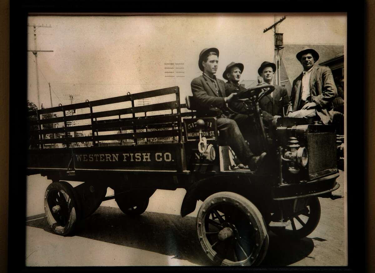 A picture of the original fish truck owned by Paul Capurro's grandfather Frank Alioto (second from right) hangs on the wall at Capurro's in San Francisco.