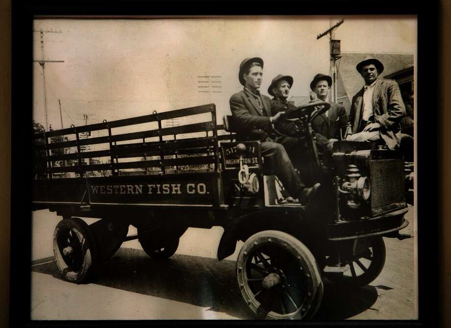 A picture of the original fish truck owned by Paul Capurro's grandfather Frank Alioto (second from right) hangs on the wall at Capurro's in San Francisco. Photo: Courtesy Of Paul Capurro