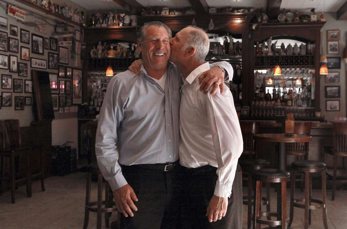 Owner Paul Capurro kissed by his brother and daytime floor manager Frank Capurro at Capurro's in San Francisco.