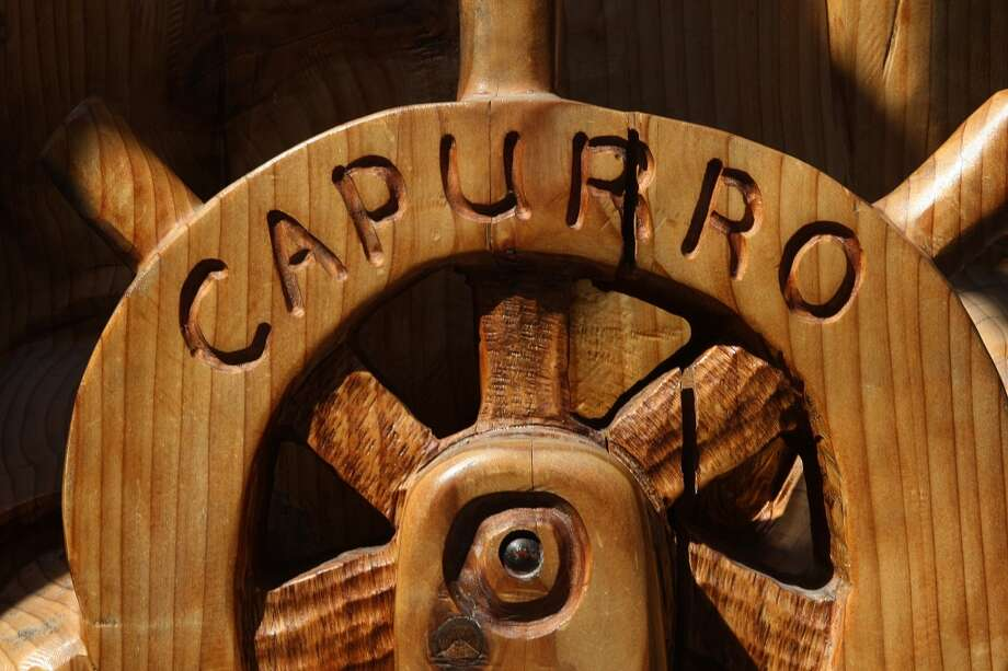 A detail of a wooden seaman statue in front of Capurro's in San Francisco. Photo: Liz Hafalia, The Chronicle