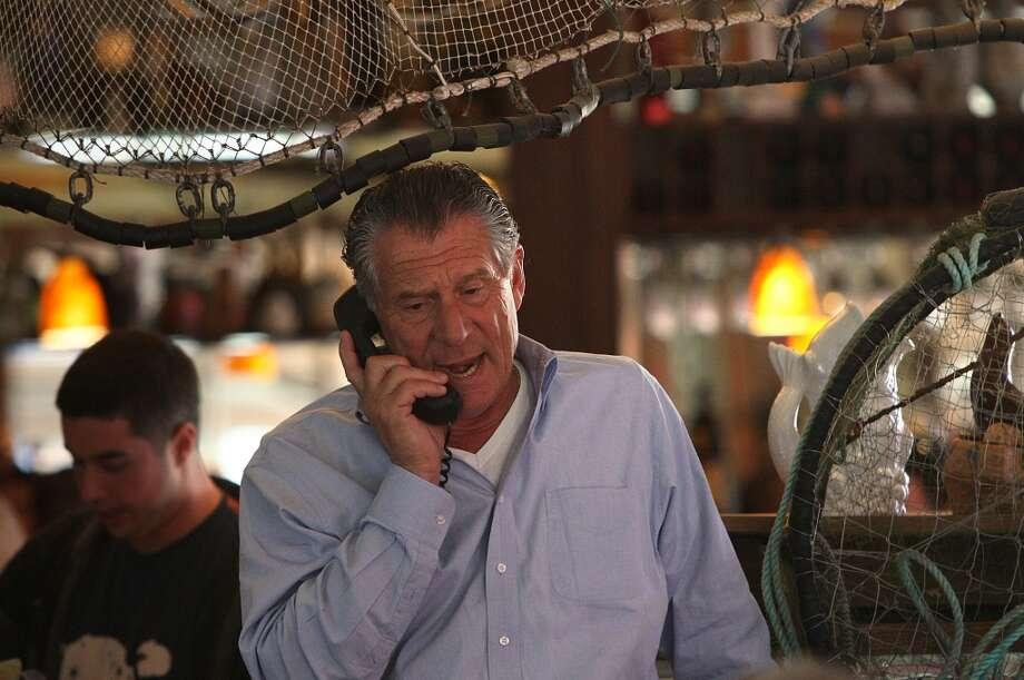 Owner Paul Capurro takes a call at Capurro's in San Francisco. Photo: Liz Hafalia, The Chronicle