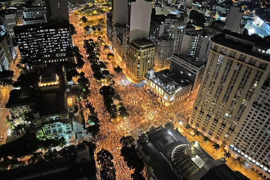"""Rio rally:Brazilian teachers and their supporters mass in the streets of Rio de Janeiro for a """"Teachers' Day"""" protest   demanding better working conditions and an end to police brutality. Photo: Vanderlei Almeida, AFP/Getty Images"""
