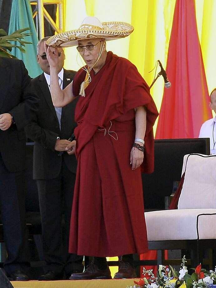 When in Rome ...The Dalai Lama - visiting San Cristobal, Mexico's Guanajuato State, for a conference - 