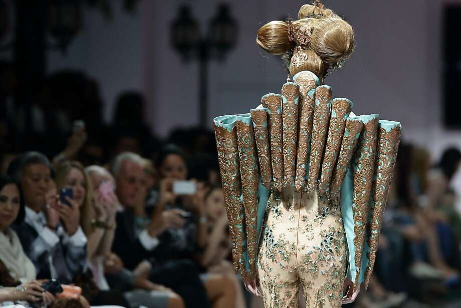 Haute tubing: Guo Pei's design for Singapore Fashion Week 2013 comes with its own exoskeleton. Photo: Suhaimi Abdullah, Getty Images
