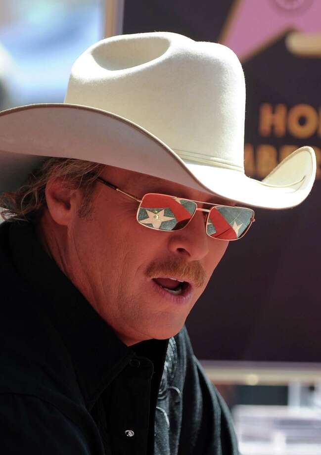 Country music performer Alan Jackson  poses at his star at the unveiling ceremony on the Hollywood Walk of Fame April 16, 2010 in the Hollywood section of Los Angeles.  AFP PHOTO / Robyn Beck (Photo credit should read ROBYN BECK/AFP/Getty Images) Photo: ROBYN BECK / AFP