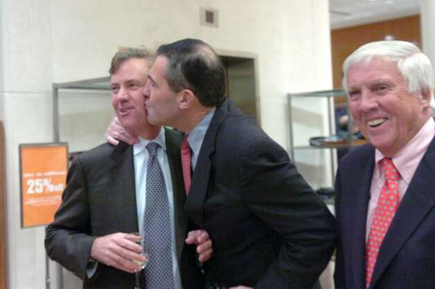 Ed Dadakis gives Ned Lamont a peck on the cheek to the amusement of Malcolm Pray as guests gather to roast former Republican Congressman Christopher Shays at Richards on Greenwich Avenue Wednesday, January 27, 2010.   Gov. M. Jodi Rell, state Sen. Scott Frantz, state Reps. Fred Camillo, Livvy Floren and Lile Gibbons, First Selectman Peter Tesei, Lamont, Linda McMahon and Bill Mitchell were all on hand for the evening which benefited SoundWaters, an educational program aimed at protecting Long Island Sound. Photo: Keelin Daly / Greenwich Time