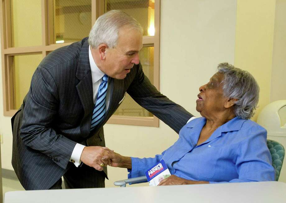 Mayoral candidate Michael Fedele shakes hands with Vivette Wilks at Stamford Green on Wednesday, Oct. 16, 2013. Photo: Lindsay Perry / Stamford Advocate