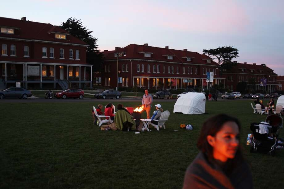 "People enjoy ""Twilight at the Presidio,"" an iteration of the Off the Grid food truck gathering, on October 2, 2013 in San Francisco, Calif. Photo: Pete Kiehart, The Chronicle"