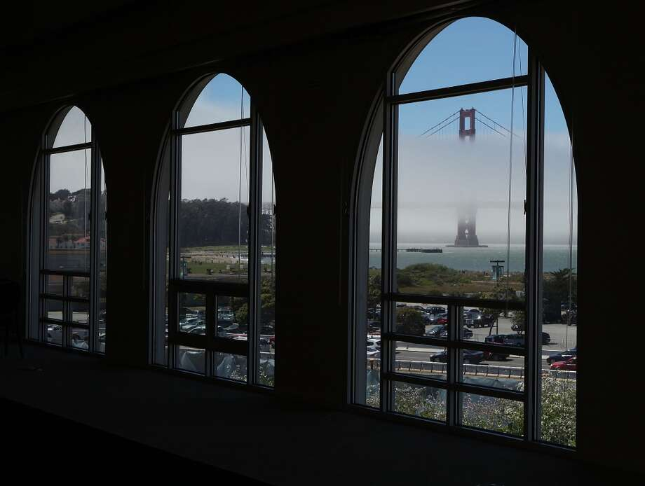 A view of  Crissy Field and the Golden Gate bridge seen through the windows of the old Burger King restaurant in the Presidio in San Francisco, Calif., on Friday, June 28, 2013. Photo: Liz Hafalia, The Chronicle