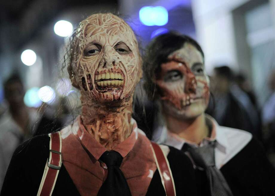 People dressed as zombies take part in a Zombie Walk in Sitges, near Barcelona, on October 12, 2013.    AFP PHOTO/ JOSEP LAGOJOSEP LAGO/AFP/Getty Images Photo: JOSEP LAGO, AFP/Getty Images / AFP