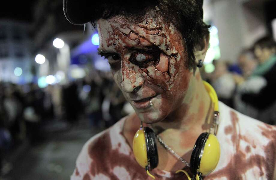 A man dressed as zombies takes part in a Zombie Walk in Sitges, near Barcelona, on October 12, 2013.    AFP PHOTO/ JOSEP LAGOJOSEP LAGO/AFP/Getty Images Photo: JOSEP LAGO, AFP/Getty Images / AFP