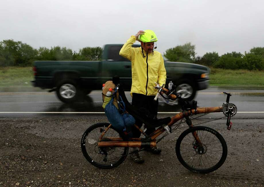 Dug Shelby of California is in the middle of a 5,000-mile bicycle ride across the country to raise awareness about human trafficking. Riding a recumbent bamboo bicycle custom-made in Brazil, Shelby passed through San Antonio before stopping in Kyle for the evening. Photo: Helen L. Montoya, SAN ANTONIO EXPRESS-NEWS / SAN ANTONIO EXPRESS-NEWS
