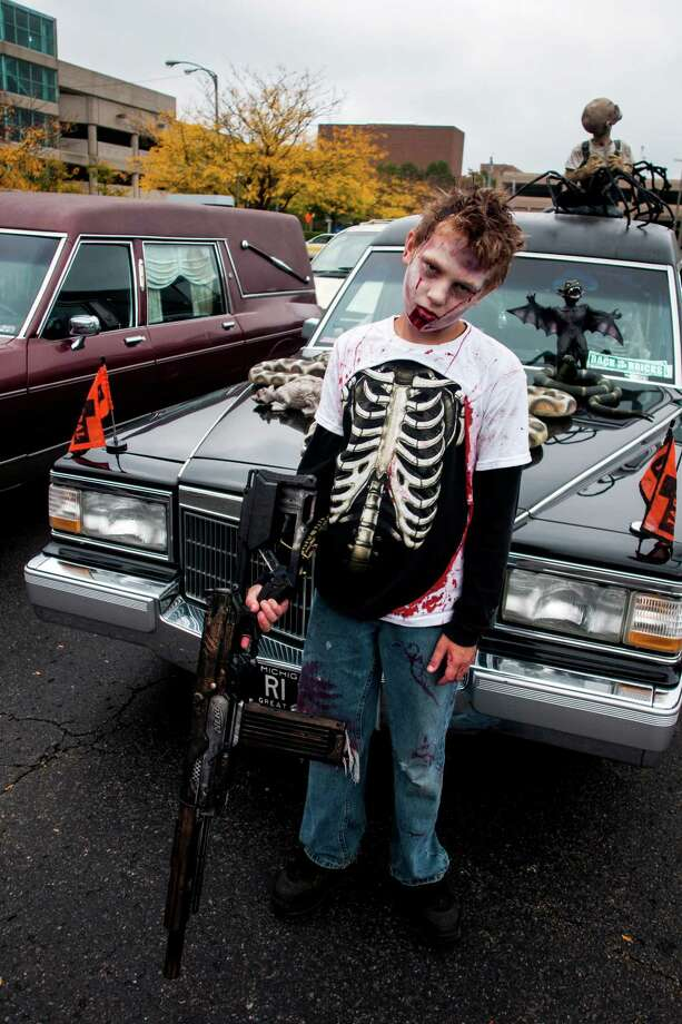"Troy Kingman, 14, of Swartz Creek, Mich.,  dresses as a gunman turned zombie in on Saturday, Oct. 5, 2013, in downtown Flint, Mich., before the fifth annual Zombie Walk. ""I'm just your everyday zombie with a ripped out diaphragm. I feel OK, but very hungry for brains,"" he said.   (AP Photo/The Flint Journal, Jake May ) LOCAL TV OUT; LOCAL INTERNET OUT Photo: Jake May, Associated Press / The Flint Journal"