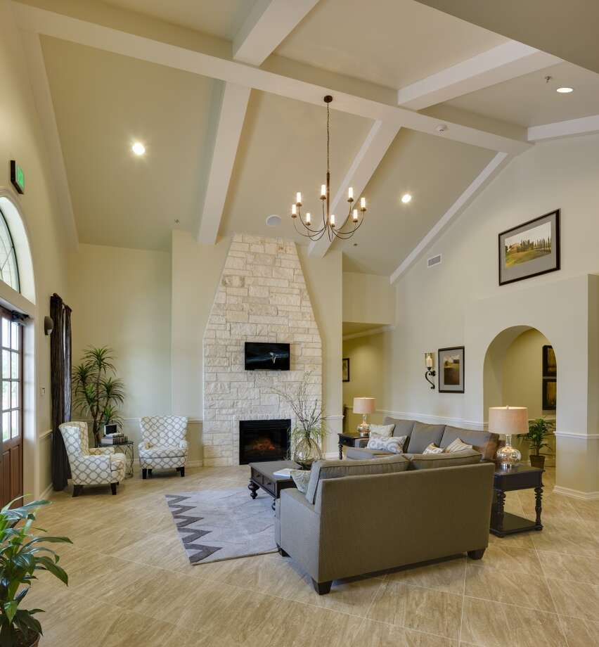 This space at the Memorial Oaks property has a fireplace and comfortable seating meant to give a warm and inviting feel. Photo: Courtesy Of Dignity Memorial